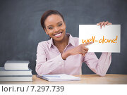Купить «Happy teacher holding page showing well done», фото № 7297739, снято 28 января 2020 г. (c) Wavebreak Media / Фотобанк Лори