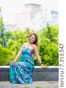 Купить «Привлекательная девушка в летнем платье», фото № 7313547, снято 6 июня 2014 г. (c) Сергей Сухоруков / Фотобанк Лори