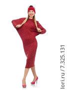 Купить «Pretty young woman in ruby dress isolated on white», фото № 7325131, снято 17 декабря 2014 г. (c) Elnur / Фотобанк Лори