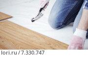 Купить «close up of man installing wood flooring», видеоролик № 7330747, снято 28 марта 2015 г. (c) Syda Productions / Фотобанк Лори
