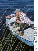 Купить «Happy man fishing with his son», фото № 7339591, снято 24 октября 2014 г. (c) Wavebreak Media / Фотобанк Лори