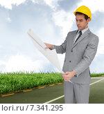 Купить «Composite image of serious architect with hard hat looking at plans», фото № 7341295, снято 18 января 2019 г. (c) Wavebreak Media / Фотобанк Лори