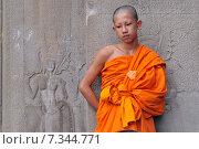 Cambodia, Siem Reap, Monk at Angkor Wat. Редакционное фото, агентство BE&W Photo / Фотобанк Лори