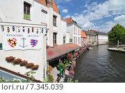 Купить «Canal and old houses in Bruges (Brugge) Belgium.», фото № 7345039, снято 17 октября 2018 г. (c) BE&W Photo / Фотобанк Лори