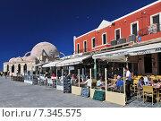 Купить «Seafront Cafes and Restaurants in the Old Venetian Harbour, Chania, Chania Province, Crete, Greece», фото № 7345575, снято 16 июля 2020 г. (c) BE&W Photo / Фотобанк Лори