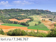 Tuscan landscape with view of Pienza, Val d'Orcia, Tuscany, Italy. Стоковое фото, агентство BE&W Photo / Фотобанк Лори
