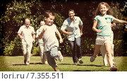Купить «Happy multi generation family racing towards camera», фото № 7355511, снято 14 декабря 2019 г. (c) Wavebreak Media / Фотобанк Лори