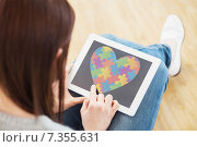 Купить «Composite image of girl using a tablet pc sitting on the floor», фото № 7355631, снято 18 января 2020 г. (c) Wavebreak Media / Фотобанк Лори