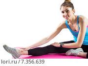 Купить «Fit woman stretching on exercise mat», фото № 7356639, снято 18 февраля 2015 г. (c) Wavebreak Media / Фотобанк Лори