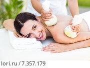 Купить «Brunette having massage with herbal compresses», фото № 7357179, снято 29 января 2015 г. (c) Wavebreak Media / Фотобанк Лори