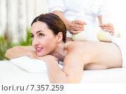 Купить «Brunette having massage with herbal compresses», фото № 7357259, снято 29 января 2015 г. (c) Wavebreak Media / Фотобанк Лори
