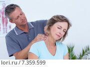 Купить «Doctor massaging his patient neck», фото № 7359599, снято 16 января 2015 г. (c) Wavebreak Media / Фотобанк Лори