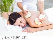 Купить «Brunette having massage with herbal compresses», фото № 7361331, снято 29 января 2015 г. (c) Wavebreak Media / Фотобанк Лори