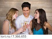 Купить «Composite image of friends drinking champagne», фото № 7366655, снято 10 июля 2020 г. (c) Wavebreak Media / Фотобанк Лори