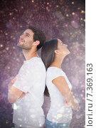Купить «Composite image of happy couple standing looking up», фото № 7369163, снято 20 марта 2019 г. (c) Wavebreak Media / Фотобанк Лори