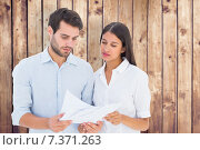 Купить «Composite image of attractive young couple reading their bills», фото № 7371263, снято 20 марта 2019 г. (c) Wavebreak Media / Фотобанк Лори