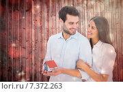 Купить «Composite image of attractive young couple holding a model house», фото № 7372263, снято 20 марта 2019 г. (c) Wavebreak Media / Фотобанк Лори
