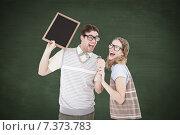 Купить «Composite image of geeky hipster couple singing into a microphone», фото № 7373783, снято 23 января 2020 г. (c) Wavebreak Media / Фотобанк Лори