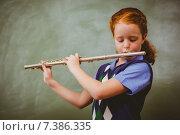 Купить «Cute little girl playing flute in classroom», фото № 7386335, снято 9 ноября 2014 г. (c) Wavebreak Media / Фотобанк Лори