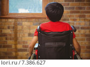 Купить «Rear view of boy sitting in wheelchair», фото № 7386627, снято 9 ноября 2014 г. (c) Wavebreak Media / Фотобанк Лори