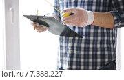 Купить «close up of man with measuring ruler and clipboard», видеоролик № 7388227, снято 28 марта 2015 г. (c) Syda Productions / Фотобанк Лори