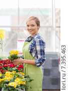 Купить «happy woman holding flowers in greenhouse», фото № 7395463, снято 25 февраля 2015 г. (c) Syda Productions / Фотобанк Лори