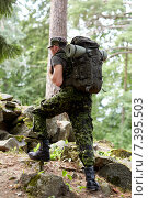 Купить «young soldier with backpack in forest», фото № 7395503, снято 14 августа 2014 г. (c) Syda Productions / Фотобанк Лори