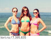Купить «group of smiling young women on beach», фото № 7395835, снято 26 июля 2014 г. (c) Syda Productions / Фотобанк Лори