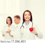 Купить «smiling female doctor with heart and stethoscope», фото № 7396451, снято 20 декабря 2013 г. (c) Syda Productions / Фотобанк Лори