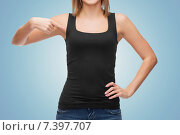 Купить «close up of woman in blank black tank top», фото № 7397707, снято 5 декабря 2013 г. (c) Syda Productions / Фотобанк Лори