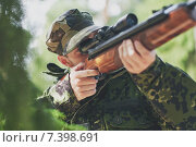Купить «soldier or hunter shooting with gun in forest», фото № 7398691, снято 14 августа 2014 г. (c) Syda Productions / Фотобанк Лори
