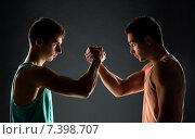 Купить «young men wrestling», фото № 7398707, снято 22 сентября 2014 г. (c) Syda Productions / Фотобанк Лори