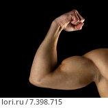 Купить «close up of young man showing biceps», фото № 7398715, снято 22 сентября 2014 г. (c) Syda Productions / Фотобанк Лори