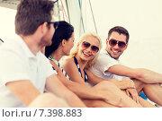 Купить «smiling friends sitting on yacht deck», фото № 7398883, снято 13 июля 2014 г. (c) Syda Productions / Фотобанк Лори