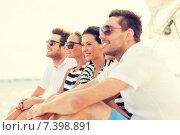 Купить «smiling friends sitting on yacht deck», фото № 7398891, снято 13 июля 2014 г. (c) Syda Productions / Фотобанк Лори