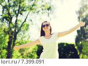 Купить «smiling young woman with sunglasses in park», фото № 7399091, снято 11 июля 2014 г. (c) Syda Productions / Фотобанк Лори