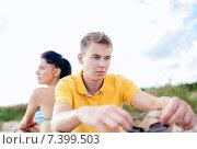 Купить «unhappy couple sitting on beach», фото № 7399503, снято 31 августа 2013 г. (c) Syda Productions / Фотобанк Лори