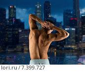Купить «young man or bodybuilder showing muscles», фото № 7399727, снято 22 сентября 2014 г. (c) Syda Productions / Фотобанк Лори