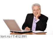 Купить «Elderly businessman with laptop», фото № 7412991, снято 28 августа 2013 г. (c) Ruslan Huzau / Фотобанк Лори