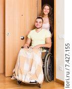 Купить «Worker brought person in wheelchair», фото № 7427155, снято 26 мая 2018 г. (c) Яков Филимонов / Фотобанк Лори