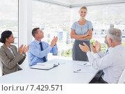 Купить «Business team applauding their colleague», фото № 7429571, снято 14 марта 2015 г. (c) Wavebreak Media / Фотобанк Лори