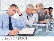 Купить «Tired business team at conference», фото № 7429671, снято 14 марта 2015 г. (c) Wavebreak Media / Фотобанк Лори