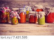 Купить «Vegetable preserves on wooden background», фото № 7431595, снято 5 апреля 2014 г. (c) Майя Крученкова / Фотобанк Лори