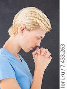 Купить «Pretty blond woman praying», фото № 7433263, снято 29 января 2015 г. (c) Wavebreak Media / Фотобанк Лори