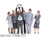 Купить «Excited business team cheering at camera with trophy», фото № 7436771, снято 18 марта 2015 г. (c) Wavebreak Media / Фотобанк Лори