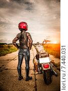 Купить «Biker girl on a motorcycle», фото № 7440031, снято 13 августа 2014 г. (c) Андрей Армягов / Фотобанк Лори