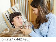 Купить «woman giving medicinal syrup to husband», фото № 7442495, снято 28 марта 2014 г. (c) Яков Филимонов / Фотобанк Лори