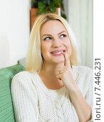 Купить «Woman having cunning look indoors», фото № 7446231, снято 18 декабря 2018 г. (c) Яков Филимонов / Фотобанк Лори