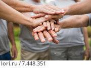 Купить «Happy volunteer family putting their hands together», фото № 7448351, снято 24 марта 2015 г. (c) Wavebreak Media / Фотобанк Лори