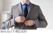 Купить «close up of man in suit fastening button on jacket», видеоролик № 7452631, снято 12 апреля 2015 г. (c) Syda Productions / Фотобанк Лори